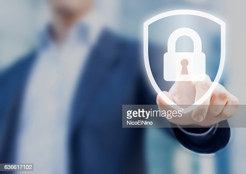 Person touching shield with lock, concept about security, cybersecurity, protection : Stock Photo