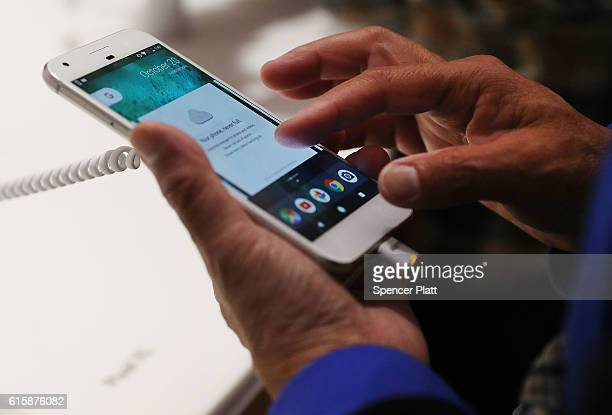 A person tries a new Google Pixel phone at the Google popup shop in the SoHo neighborhood on October 20 2016 in New York City The shop lets people...