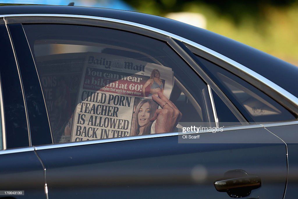 A person uses a copy of the Daily Mail newspaper to shield their identity from the demonstrators and the media as they arrive at The Grove hotel, which is hosting the annual Bilderberg conference, on June 6, 2013 in Watford, England. The traditionally secretive conference, which has taken place since 1954, is expected to be attended by politicians, bank bosses, billionaires, chief executives and European royalty.