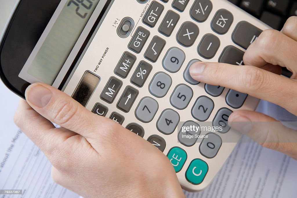Person Using A Calculator Photo – Nc Child Support Worksheet a
