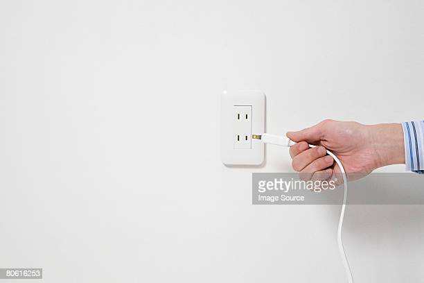 Person using a plug