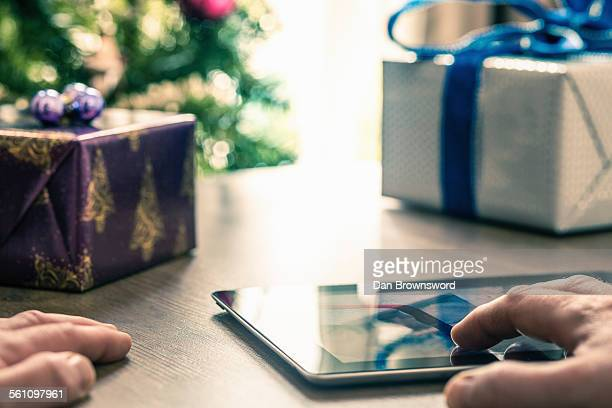 Person using digital tablet, close up