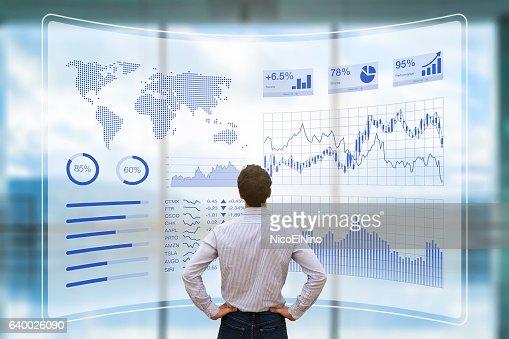 Person using futuristic HUD interface, KPI and BI, technology, data : Foto stock