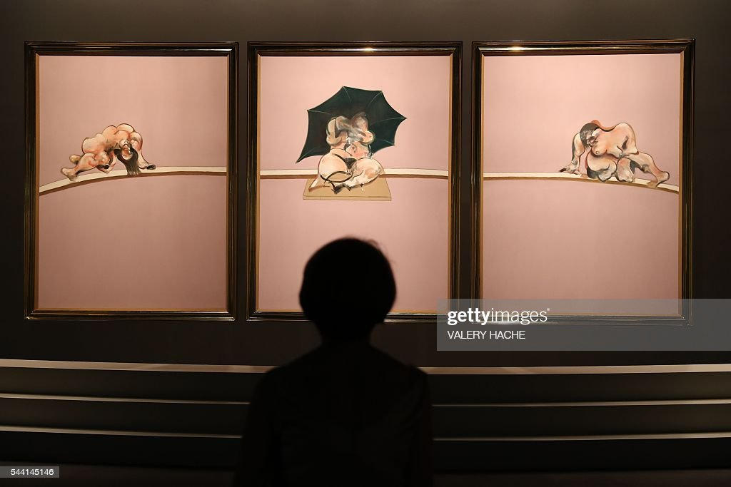 A person visits the exhibition 'Francis Bacon' in Monaco on July 1, 2016. The exhibition will run from July 2 to September 4 at the 'Grimaldi Forum'. / AFP / VALERY