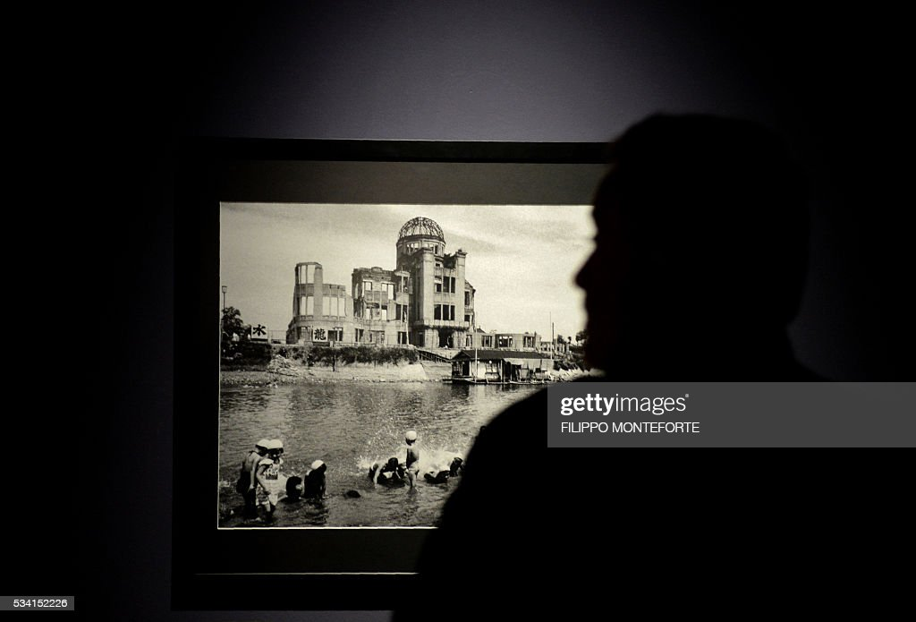 A person visits the exhibition of Japanese photographer Domon Ken (1909-1990) during a press preview at the Ara Pacis Museum (Museo dell'Ara Pacis) on May 25, 2016 in Rome. The show will run from May 27, 2016 to September 18, 2016 to mark 150th years of friendship between Japan and Italy. / AFP / FILIPPO