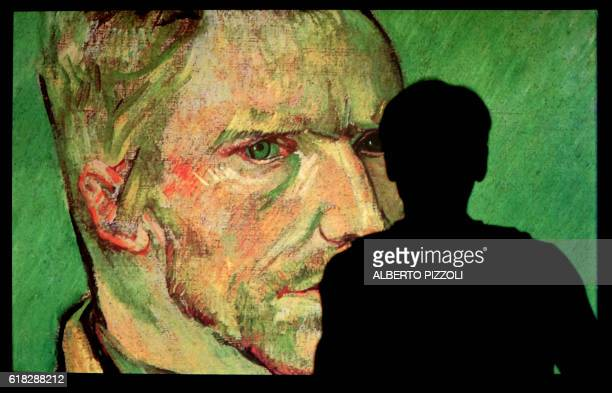 A person visits the exhibition 'Van Gogh Alive The Experience' life and work of Vincent Van Gogh from 1880 until 1890 on October 26 2016 in Rome...