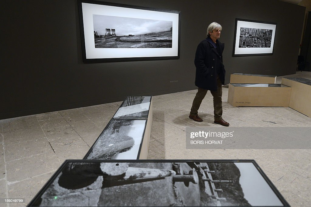 A person visits the exhibition 'Vestiges' by Czech photographer, Josef Koudelka at 'La vieille charité' on January 10, 2013 in Marseille, one of numerous exhibitions opening in Marseille in relation to the city being named 2013 European capital of culture. On January 12, the city will be named capital of culture which will kick off a range of exhibitions and events.