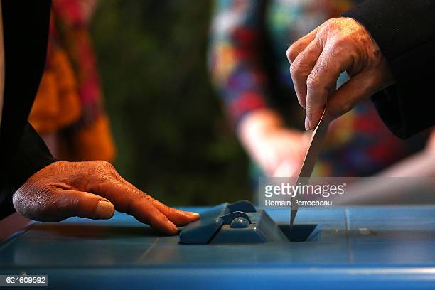 A person votes at a polling station on November 20 2016 in Bordeaux France Seven centreright candidates are running in the Republican Party's primary...