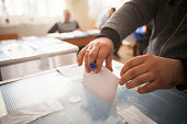 A person casts her ballot during voting for parliamentary elections at a polling station in Bucharest, Romania.