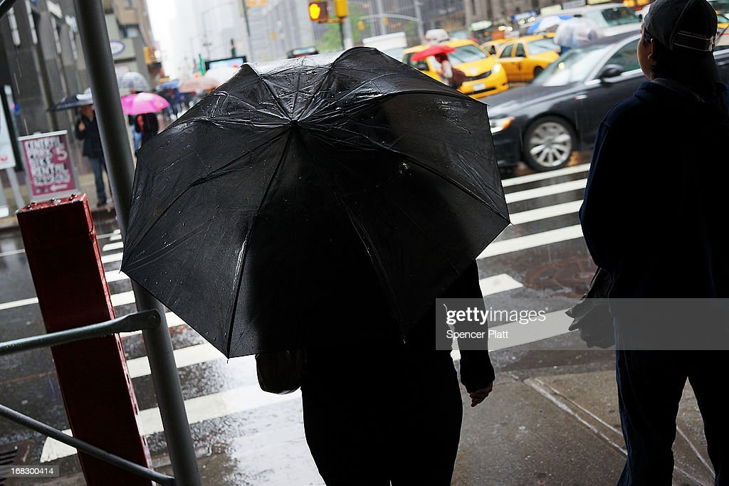A person waits to cross the street during a rain storm on May 8, 2013 in New York City. After experiencing an unusually dry spring in recent weeks, New York was hit with heavy rain Wednesday that resulted in numerous flash floods and heavy downpours.
