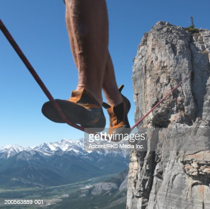 Person walking on tightrope, low section