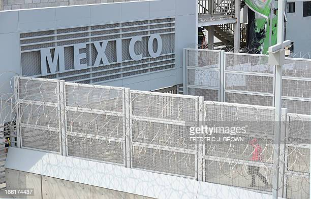 MACOR 'EEUUMIGRACIÓNSEGURIDADHISPANOS' A person walks across a bridge at the USMexico border from the San Ysidro port of entry near San Diego...