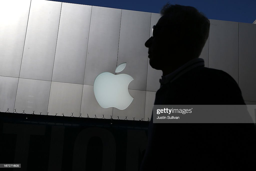 A person walks by an Apple Store on April 23, 2013 in San Francisco, California. Analysts believe that Apple Inc. will report their first quarterly loss in nearly a decade as the company prepares to report first quarter earnings today after the closing bell.