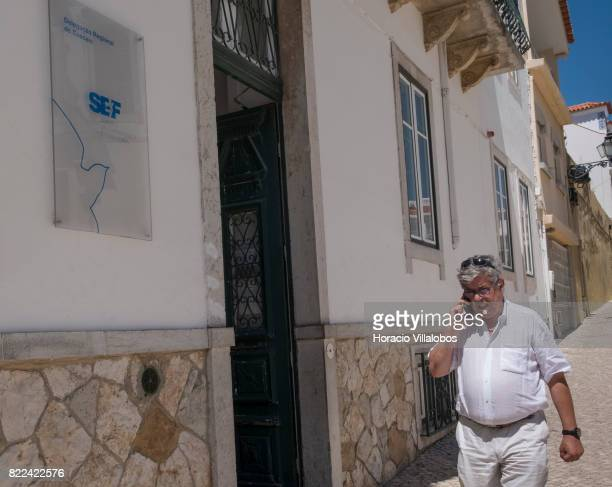 A person walks by Portugal's SEF Regional Delegation on July 25 2017 in Cascais Portugal According to the SEF the number of citizens from other...