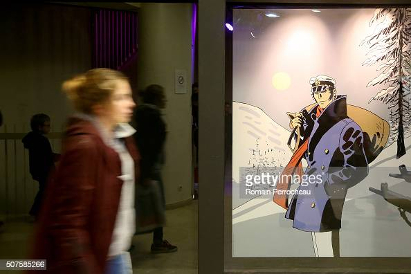 A person walks during Angouleme 41st International Cartoonists Festival opening on January 30 2016 in Angouleme France
