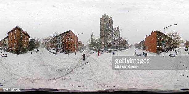 A person walks in blizzardlike conditions on January 23 2016 in the Brooklyn borough of New York City The Northeast and parts of the South are...