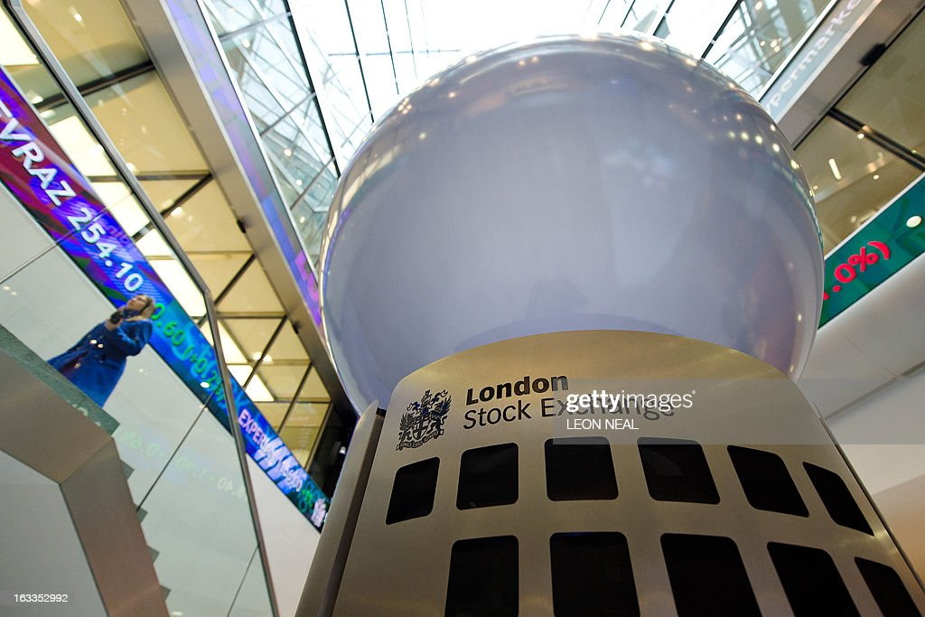 A person walks in the foyer of the London Stock Exchange in central London on March 7 2013 AFP PHOTO / LEON NEAL