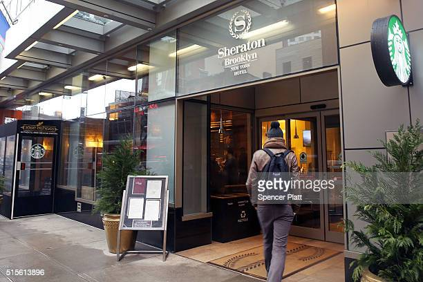 A person walks in to a Sheraton Hotel in downtown Brooklyn on March 14 2016 in New York City A fight for the Starwood Hotel chain which Sheraton is a...