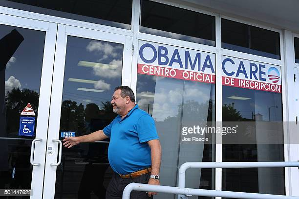 A person walks into the UniVista Insurance company office where people are signing up for health care plans under the Affordable Care Act also known...