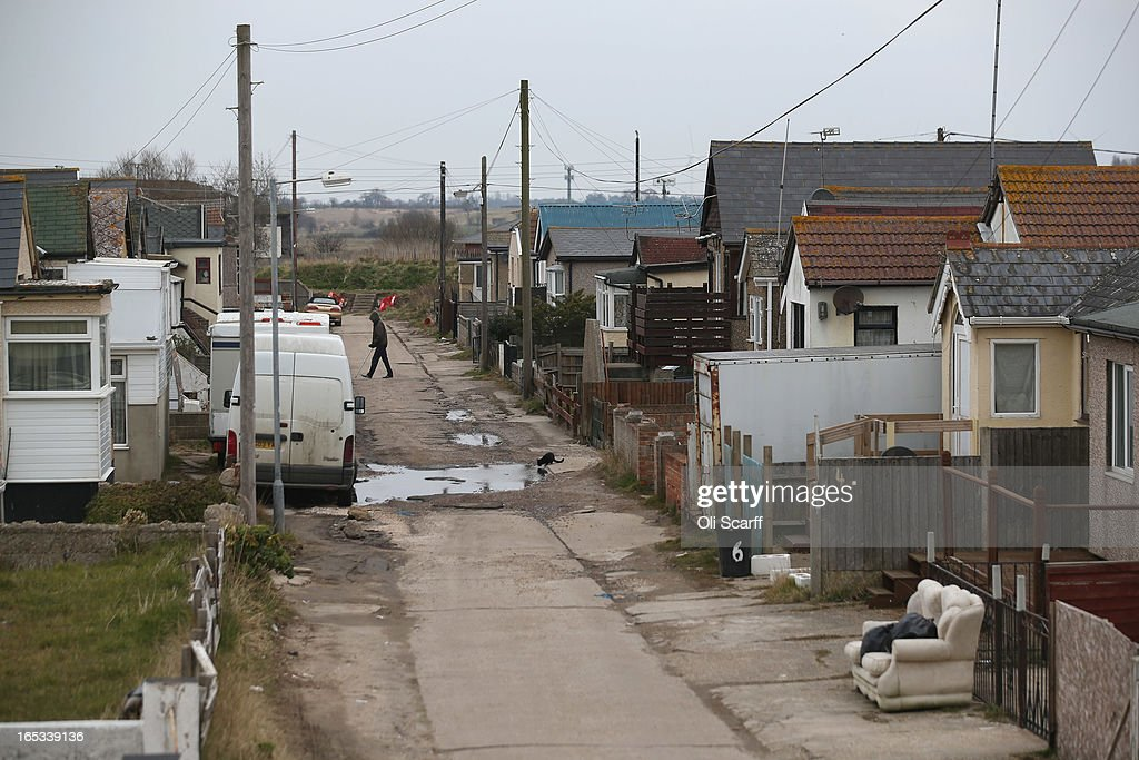 A person walks near dilapidated properties in the seaside town of East Jaywick, the most deprived place in England, on April 3, 2013 in Jaywick, England. The Government's 2011 Indices of Multiple Deprivation' measure ranks Jaywick as the most deprived of all 32,482 small wards in England and Wales. The area also has the greatest number of young people not in employment, education or training; one third of 16 to 24 year-olds claim Jobseeker's Allowance, compared to the national average of 6 per cent. Changes to the benefits and tax system which came into force on April 1, 2013 have included a cut in housing benefit payments for working-age social housing tenants whose property is deemed larger than they need and council tax support payments now being administered locally.