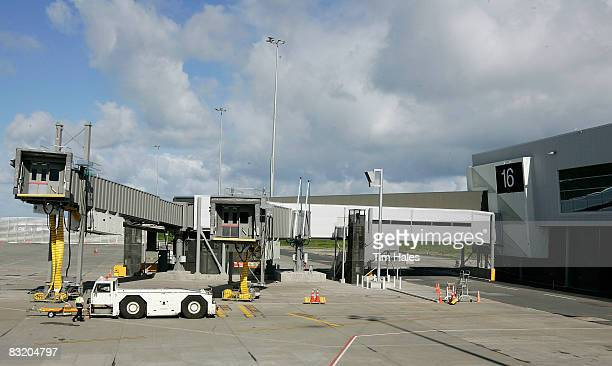 A person walks near the airbridge for the A380 at the new pier at Auckland International Airport October 10 2008 in Auckland New Zealand The...