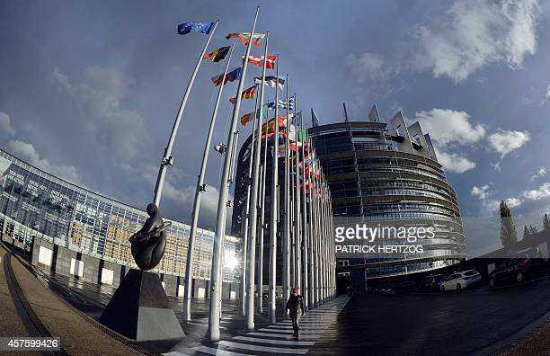 A person walks on October 21 2014 in front of the European Parliament in Strasbourg eastern France during a plenary session AFP PHOTO / PATRICK...