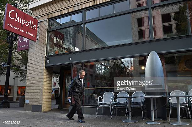 A person walks past a Chipotle Mexican Grill store location in downtown Portland on November 3 2015 in Portland Oregon Chipotle Mexican Grill is...