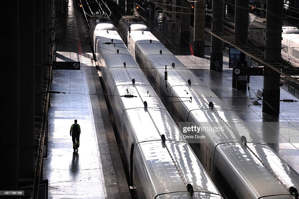 A person walks past a departing AVE highspeed train at Atocha train station on October 8 2015 in Madrid Spain A total of 20 trains and 7000...