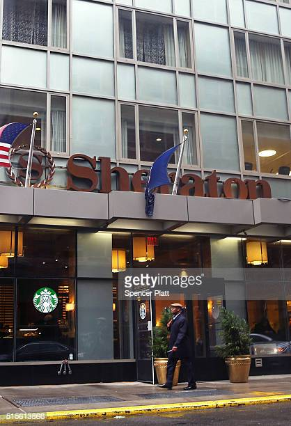 A person walks past a Sheraton Hotel in downtown Brooklyn on March 14 2016 in New York City A fight for the Starwood Hotel chain which Sheraton is a...