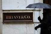 A person walks past a Tiffany Co store along Wall Street in Manhattan on January 12 2015 in New York City Shares in the luxury jewelry chain fell on...