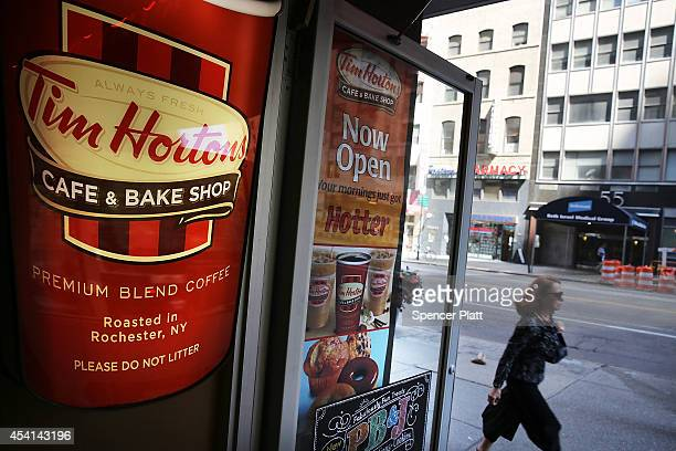 A person walks past a Tim Horton's cafe in Manhattan on August 25 2014 in New York City It has been confirmed that American fast food giant Burger...