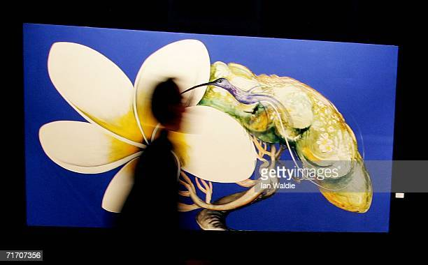 A person walks past Australian artist Brett Whiteley's painting 'Hummingbird and Frangipini' during a viewing of some important Australian paintings...