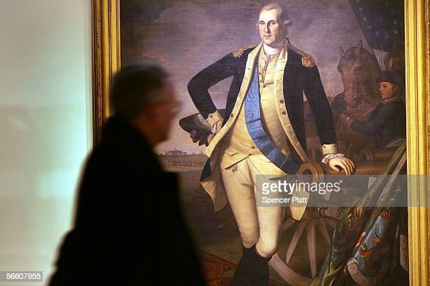 A person walks past the full length portrait of George Washington by Charles Wilson Peale at Christie's auction house January 17 2006 in New York...