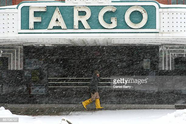 A person walks through falling snow March 302009 in downtown Fargo North Dakota Fargo and the surrounding area are expecting a storm Monday that...