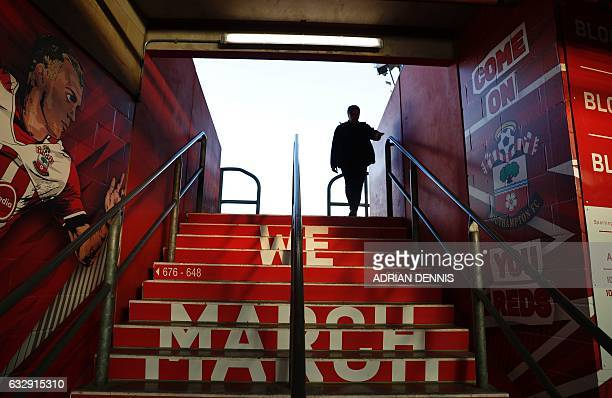 A person walks throught the stands ahead of the English FA Cup fourth round football match between Southampton and Arsenal at St Mary's in...