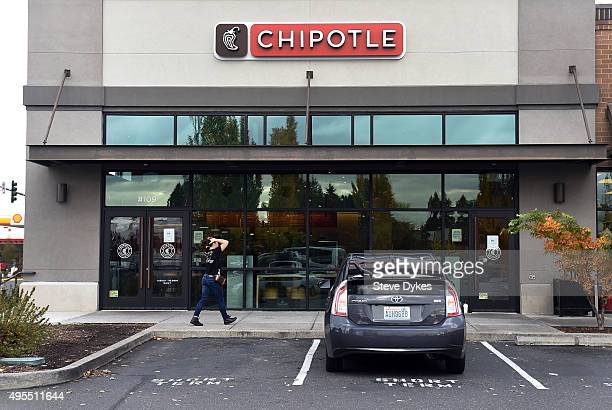 A person walks up to a Chipotle Mexican Grill store location in on November 3 2015 in Vancouver Washington Chipotle Mexican Grill is temporarily...