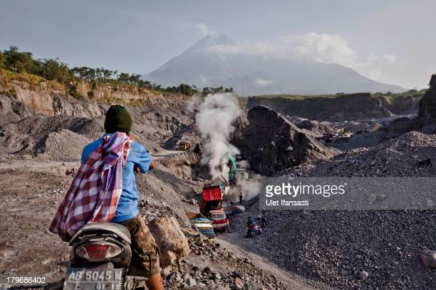 A person watches sand mining in Gendol River riverbed September 6 2013 in Yogyakarta Indonesia Mount Merapi is considered to be one of the worlds...