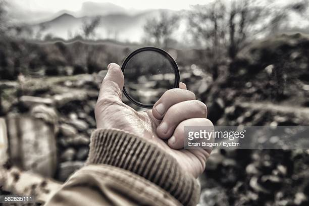 Person Watching Nature Through Magnifying Glass