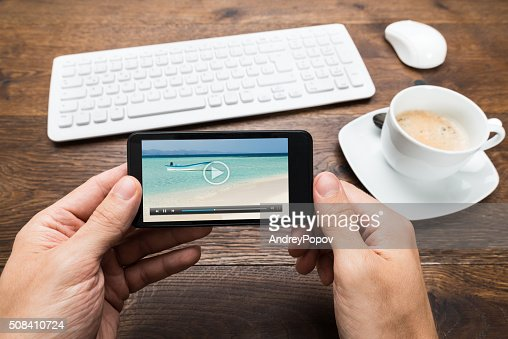 Person Watching Video On Mobile Phone : Stock Photo