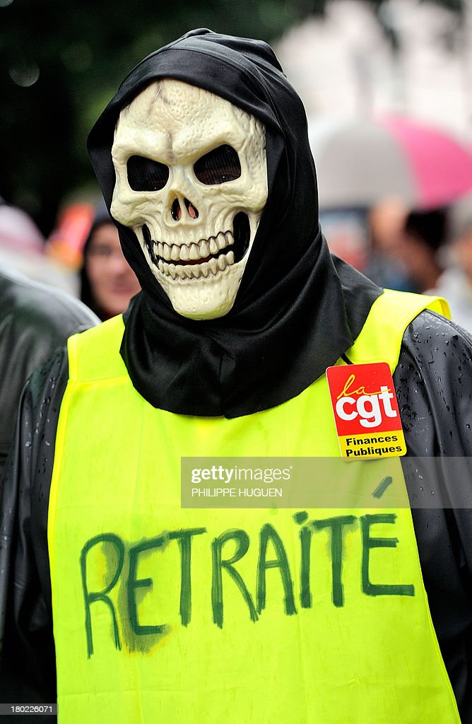 A person wearing a skull mask takes part in a march as part of a nationwide day of protest against the government's plans to reform France's debt-ridden pension system, on September 10, 2013 in Lille. CGT union has called for protests in 180 locations across France, joined by student unions and far-left groups that denounce a reform they say will penalize workers and make youths pay an unfair share of the burden.