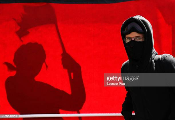 A person wearing face protection attends a May Day protest in Union Square on May 1 2017 in New York City Across the country and world people are...