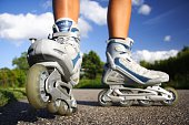 Inline skates in action closeup. Shallow depth of field, focus on left skate. See more: