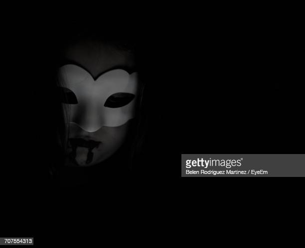 Person Wearing Mask In Darkroom