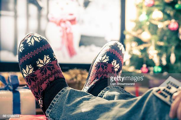 Person wearing slippers with feet up