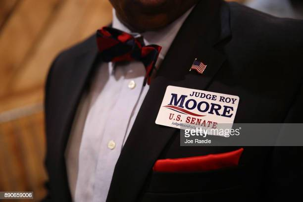 A person wears a campaign sticker for Republican Senatorial candidate Roy Moore during a campaign event at Jordan's Activity Barn on December 11 2017...