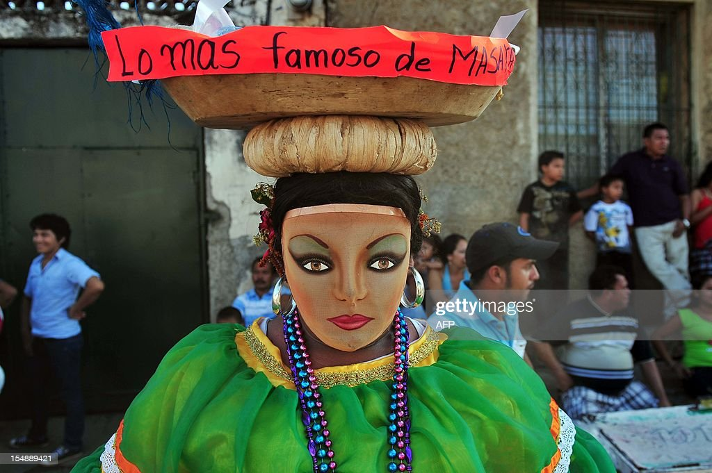 A person wears a costume during the 'Torovenado' carnival held in the framework of San Jeronimo celebrations, the patron saint of Masaya, 30 km from Managua, on October 28, 2012. The festivities honouring San Jeronimo - which are known as the longest festivities in Nicaragua - began September 20 and end the last Sunday of November. AFP PHOTO/Hector RETAMAL