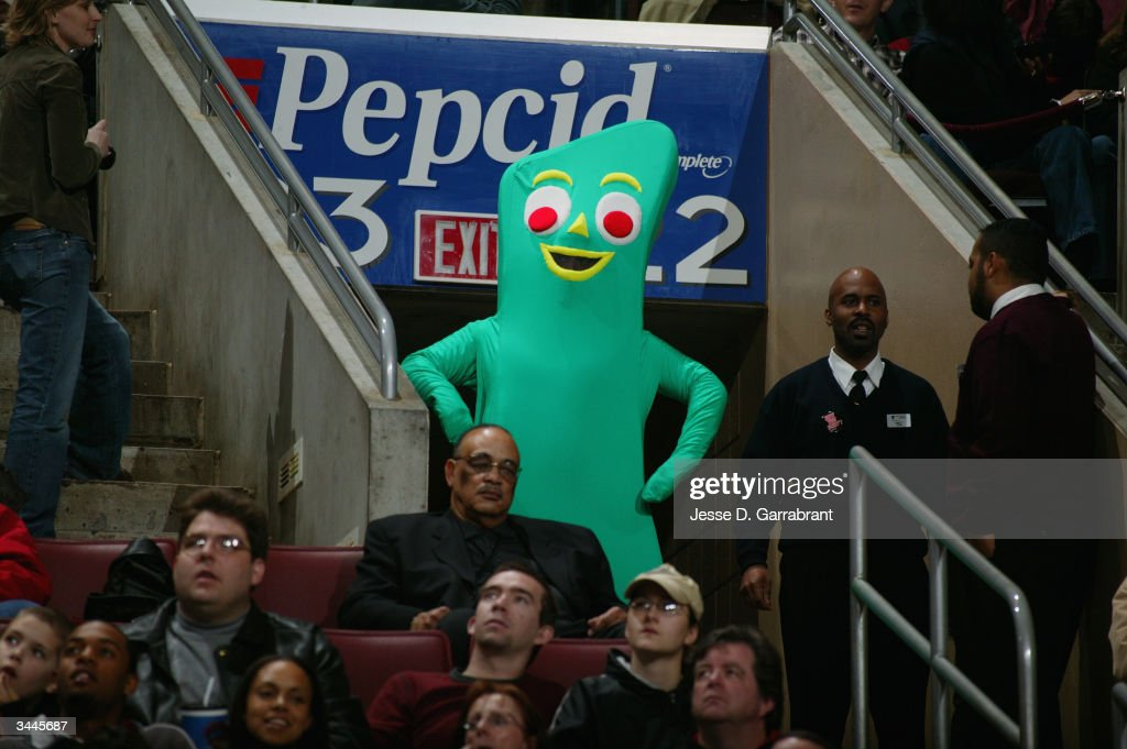 A person wears a costume of the television character Gumby while watching the game from the stands between the New York Knicks and the Philadelphia...
