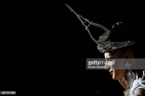 A person wears a crown with the shape of the Mole Antonelliana the major landmark in Turin during the annual Lesbian Gay Bisexual and Transgender...