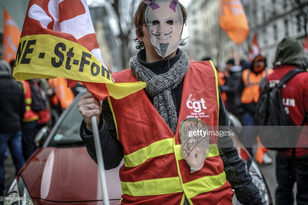 A person wears a Gary Klesch (Kem One CEO) mask as employees of Kem One, a company specializing in chlorochemicals and vinyl products, demonstrate to keep their jobs, on March 1, 2013 in front of Kem One's headquarters in Lyon. AFP PHOTO / JEFF PACHOUD