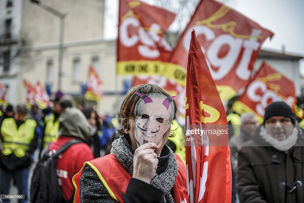 A person wears a Gary Klesch (Kem One CEO) mask as employees of Kem One, a company specializing in chlorochemicals and vinyl products, demonstrate to keep their jobs, on March 1, 2013 in front of Kem One's headquarters in Lyon.